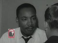 WSB-TV newsfilm clip of Dr. Martin Luther King, Jr. speaking about the civil rights movement after being arrested during a sit-in at Rich's Department Store, Atlanta, Georgia, 1960 October 19