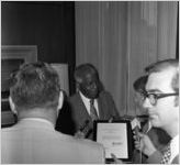 Governor Jimmy Carter with Dr. Benjamin E. Mays being interviewed by WSB after recieving the Outstanding Older Georgian Award, Morehouse College, Atlanta, Georgia, August 6, 1971