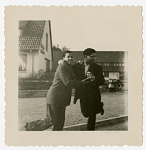 [Dizzy Gillespie dancing with a man in outdoor setting, undated photo.] [Black-and-white photoprint]