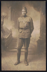 [Lieutenant Wesley Herbert Jamison of 351st Machine Gun Battalion, 92nd Infantry Division in uniform and overseas cap in front of painted backdrop]