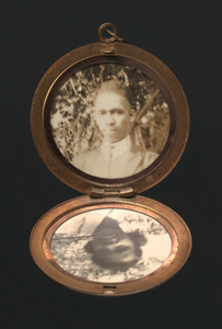 Locket with photographs of Harriette and Harry T. Moore