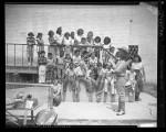 Cowboy Sam Garrett demonstrating roping trick to children at Echo Park in Los Angeles, Calif., 1949