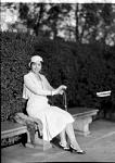 Mme. Evanti [Lillian Evans Tibbs, sitting on bench in park : acetate film photonegative]