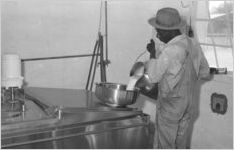 African American man pouring milk