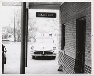 "Mississippi State Sovereignty Commission photograph of a sign reading ""Colored Cafe"" outside the rear entrance to Stanley's Cafe, Winona, Mississippi, 1961 November 1"