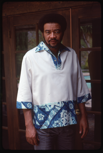 Bill Withers: portrait in front of french doors