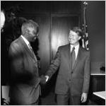 Governor Jimmy Carter shaking hands with Dr. Benjamin E. Mays who recieved the Outstanding Older Georgian Award, Morehouse College, Atlanta, Georgia, August 6, 1971