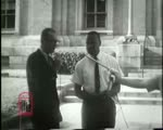 WALB newsfilm clip of police chief Laurie Pritchett, Albany Movement vice-president Slater King, and Albany Movement president William G. Anderson answering reporter's questions on the steps of the Atlanta Federal Courthouse in Atlanta, Georgia, 1962 July 24
