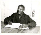 Alfred Murphy, an ex-slave learing to read and write