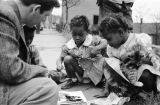 Thumbnail for Jasper Wood Collection: Children looking at a book