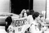 Bakke Decision Protest depicting people marching and holding protest signs in Seattle, Washington, 1977