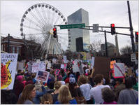 Crowd of protesters on Andrew Young International Boulevard in front of Atlanta SkyView Ferris wheel, Atlanta March for Social Justice and Women, 2017-01-21