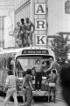 """Bodybuilders standing around and on top of a bus during the filming of the movie """"Stay Hungry"""" in Birmingham, Alabama."""