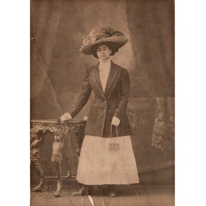 African-American woman wearing an ornate hat