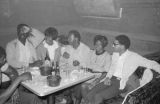 Robert Flowers, Barbara Howard Flowers, and others, seated with another man at a table at the Laicos Club in Montgomery, Alabama.