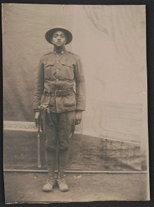[Unidentified African American military policeman in uniform and helmet with holstered handgun and billy club]