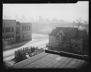 Detroit, Michigan. Looking towards downtown from the slum area in the early morning. These are conditions under which families originally lived before moving to the Sojourner Truth housing project