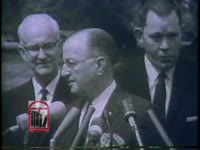 WSB-TV newsfilm clip of three Alabama newspaper editors, including Alabama Press Association president Herve Charest, speaking to reporters following a meeting with president John F. Kennedy in Washington, D.C., 1963 May 14