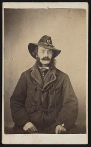 [Captain George A. Armstrong of Co. D, 7th Michigan Cavalry Regiment and Quartermaster's Dept U.S. Volunteers Infantry Regiment in uniform]
