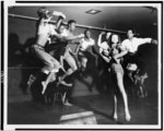 """Tropical ballet tries classic New York, N.Y. --a group of the Katherine Dunham dancers are shown in mid-air during a rehearsal of the classical ballet, """"Mozart's Sonata in D Major,"""" which they will present at the annual dinner of the Spanish Refugee Appeal, at the Waldorf-Astoria, March 18"""