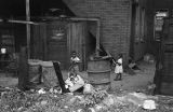 Jasper Wood Collection: Children playing behind building