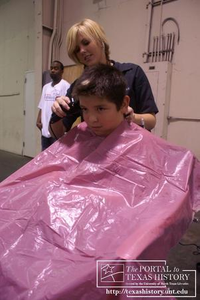 [Barber Cuts Hair of a Young Man} Education: DISD Back to School Fair, 2006-08-03