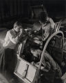 Aircraft workers assembling pilot's compartment at Glenn L. Martin plant in Canton, Baltimore