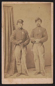 [Corporal John Reiss of Co. K, 3rd New Jersey Cavalry Regiment and Private Godfrey Lutz of Co. G, 9th Pennsylvania Infantry Regiment, Co. E, 7th New Jersey Infantry Regiment, Ermentrout's Pennsylvania Light Artillery Company, and Co. K, 3rd New Jersey Cavalry Regiment, in uniform with swords]