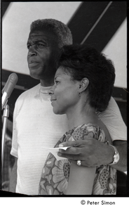 Jackie and Rachel Robinson standing at the microphone