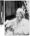 Elderly Korean man with long beard smoking a pipe, Korea, ca. 1920-1940