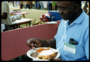[Man with Plate of Food] 1st Annual Texas Folklife Festival