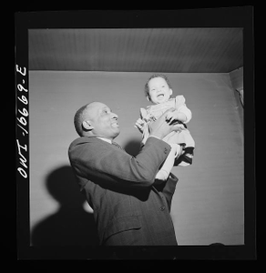 Detroit, Michigan. Negro father and child