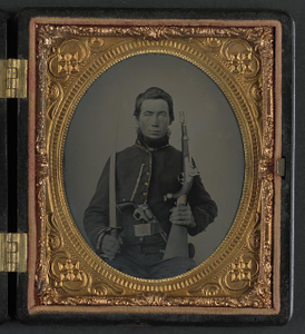 [Unidentified soldier in Union uniform with cavalry saber, single shot pistol carbine, and Colt Navy revolver]