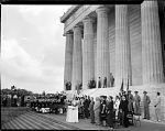 [Carol Brice at microphone, leading crowd in singing, at Lincoln Memorial, with Pres. Harry Truman and Eleanor Roosevelt standing nearby: black-and-white photonegative,] June, 28, 1947