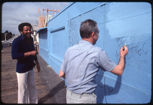 Bill Withers: Withers laughing with a man cleaning graffiti