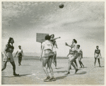 African American women, members of the 32nd and 33rd Company's Women's Army Auxiliary Corps basketball team, playing a game of basketball at Fort Huachuca