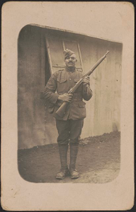 [Unidentified African American soldier in uniform, cartridge belt, and overseas cap with rifle]