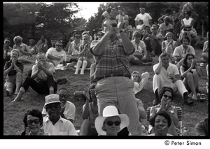 Audience member clapping enthusiastically at Jackie Robinson's jazz concert
