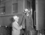 Coach Jennings saying goodbye to Ralph Metcalfe, 1932