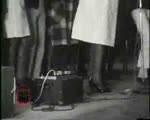 "WALB newsfilm clip of African Americans singing ""Woke up this morning with my mind on freedom"" and Dr. Martin Luther King, Jr. speaking about the connections between civil rights and economic justice in Albany, Georgia, 1962"