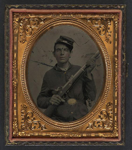 [Unidentified soldier in Union sack coat and forage cap with musket and scabbard]