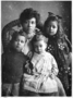 Laura Violet Roberson Lee (Mrs. Artrudo Moon Lee) with her children, from left, Artrudo Lazenberry, William F., and Alice