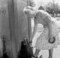 Serbia and Montenegro, woman gathering water at well in Stara Pazova
