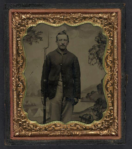 [Unidentified soldier in Union sack coat with bayoneted musket in front of painted backdrop showing military camp]