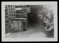 Outside corner cabin - wood box for fireplace logs; built so that J. W. J. would come outside for exercise