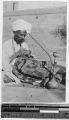 Thumbnail for Inidan fakir mending his sacred blanket, India, ca. 1900-1920