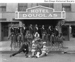 Creole Palace performers outside the entrance to the Douglas Hotel