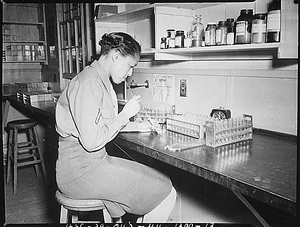 """""""Pfc. Johnnie Mae Welton, Negro WAC, laboratory technician trainee, conducts an experiment in the serology laboratory sf the Fort Jackson Station Hospital, Fort Jackson, SC."""""""
