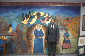 Harriet Tubman Underground Railroad Byway - Standing Before the Harriet Tubman Organization Mural
