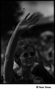 Concert goer at Jackie Robinson's jazz concert, raising her arm